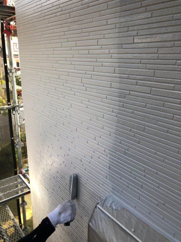 外壁上塗り状況 写真1