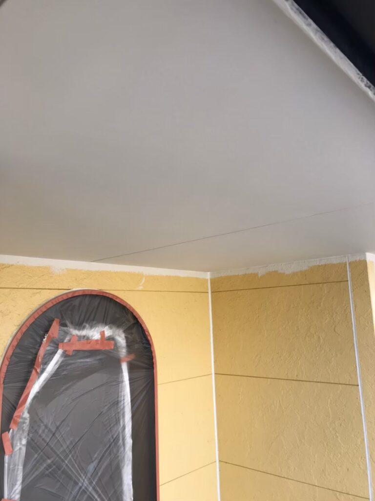 行橋市 軒天塗装と外壁下塗り 写真7